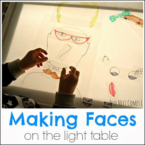 Making-faces-on-the-light-table.jpg